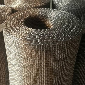 Four rolls of FeCrAl woven wire meshes with wrapped edge.