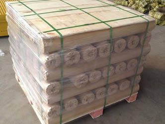 Several rolls of monel woven wire meshes are packed by a pallet and green packing belt.