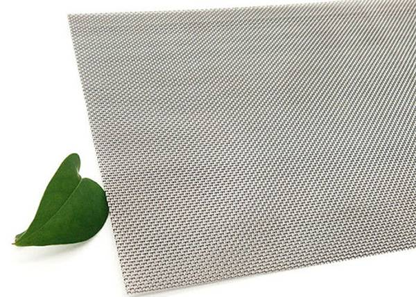 A piece of Columbium woven wire mesh on white background.